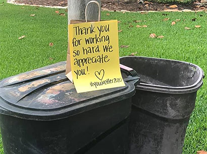 RRRTX Residential Recycling and Refuse of Texas worker appreciation note written above customer trash cans
