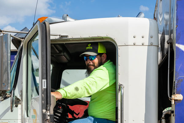 RRRTX-Residential Recycling and Refuse of Texas - Team member Patrick driving a garbage truck